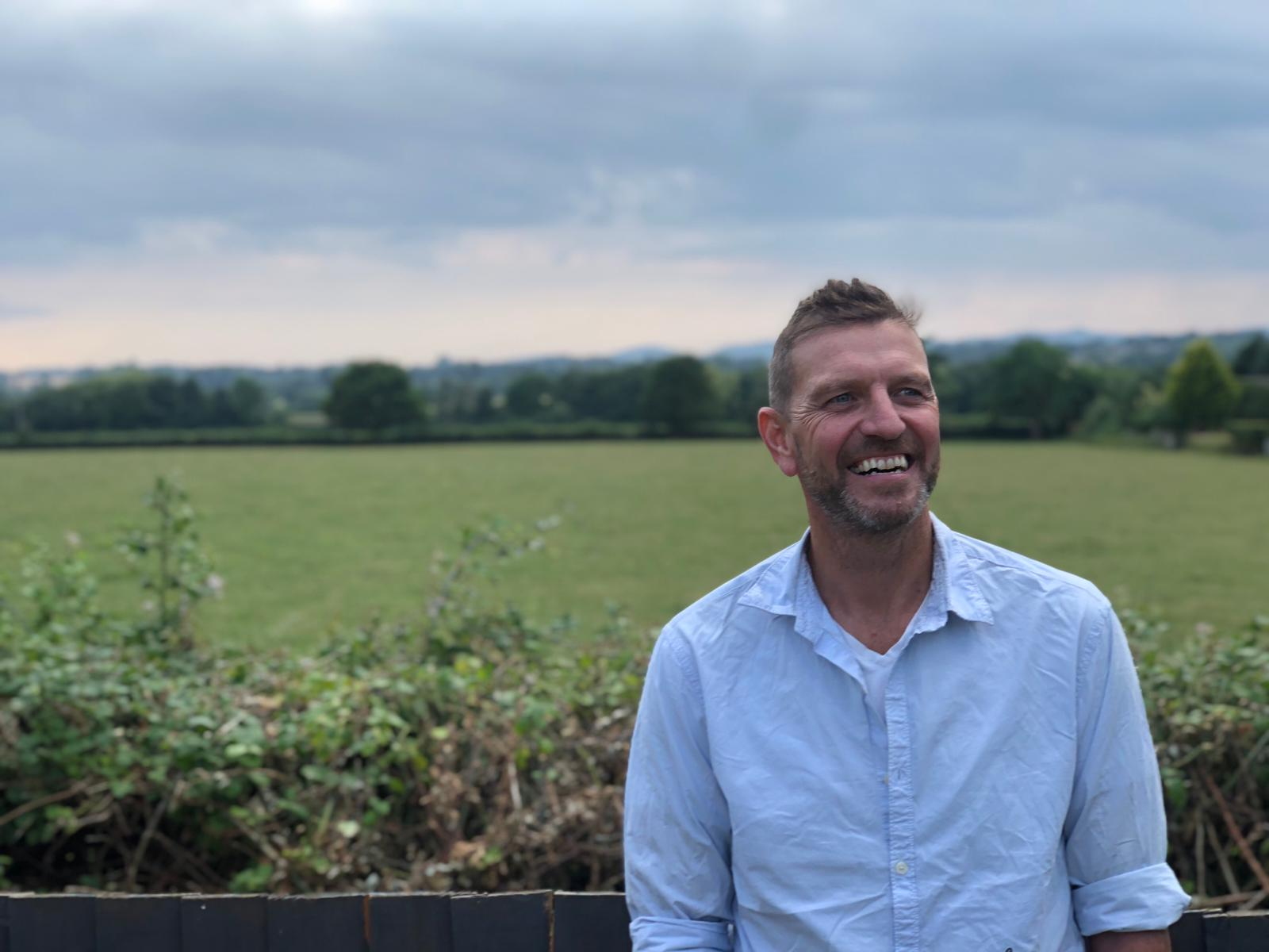 Lee Sharpe in a field in the UK as director of Pure Organic CBD