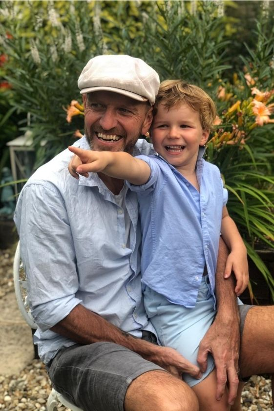 lee sharpe and his son enjoy a day together in the garden